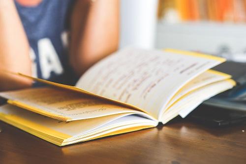girl-reading-notebook